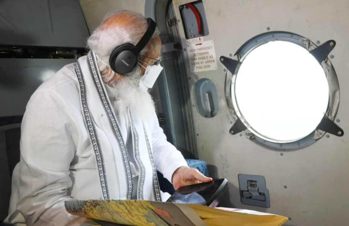 PM Narendra Modi conducting aerial survey