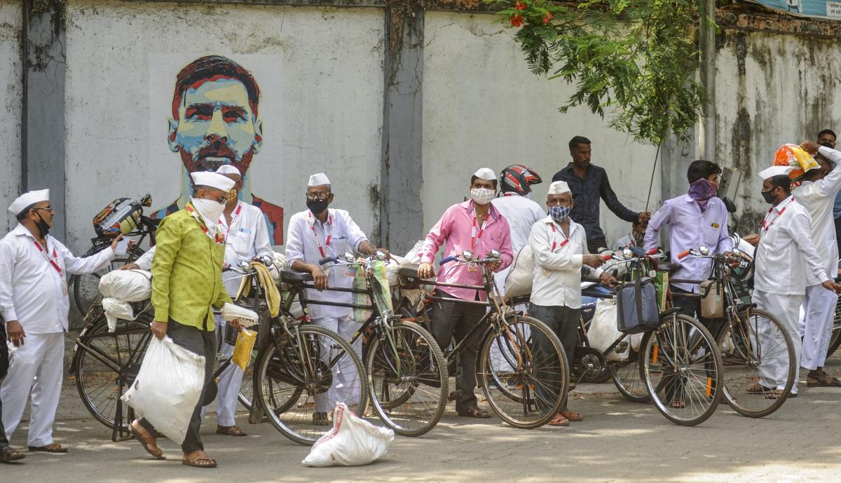 Mumbai: Nutan Mumbai dabbawala prepare to leave for work to distribute food during the COVID-induced lockdown in Mumbai, Thursday, May 27, 2021.