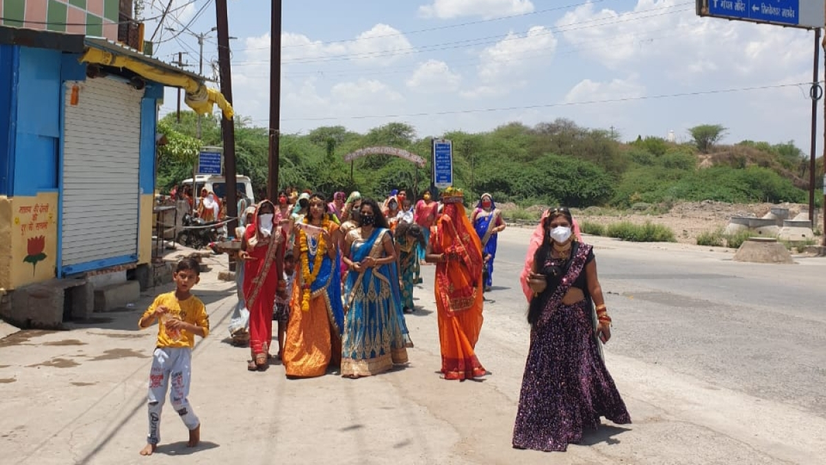Local administration booked wedding organisers, for flouting Corona Curfew norms, after preventing a bride-to-be and her kith and kin from performing Mata Puja in Tilkeshwar Colony