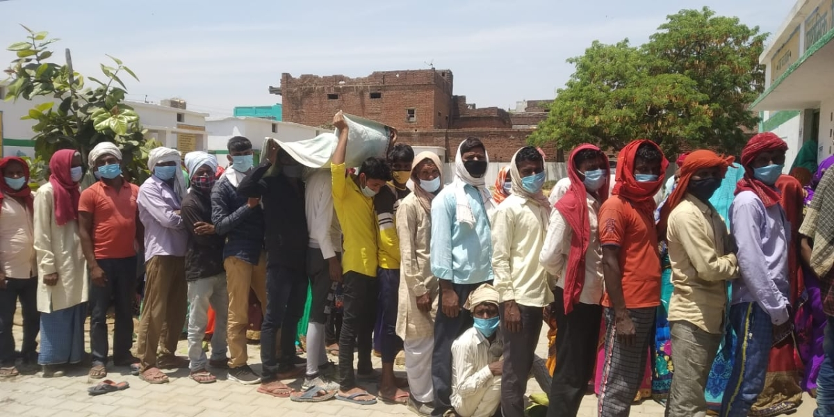 What Social Distancing? Voters line up at a polling booth for the Panchayat elections in Chandauli, UP
