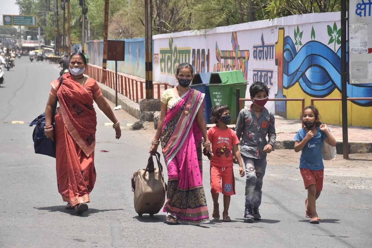 After failing to get a conveyance a family walks past Chamunda Mata Mandir Chouraha, in Ujjain on Tuesday afternoon.