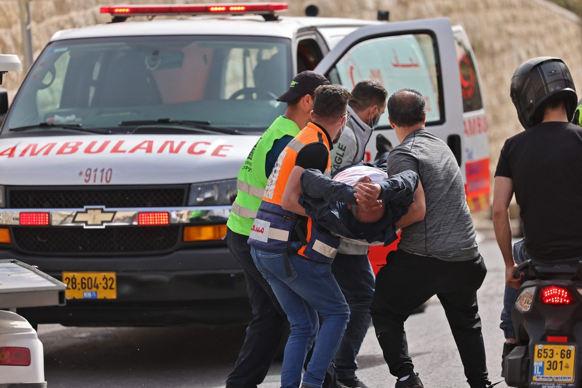 Palestinian medics evacuate a wounded protester amid clashes with Israeli security forces in Jerusalems Old City on May 10, 2021, ahead of a planned march to commemorate Israels takeover of Jerusalem in the 1967 Six-Day War.