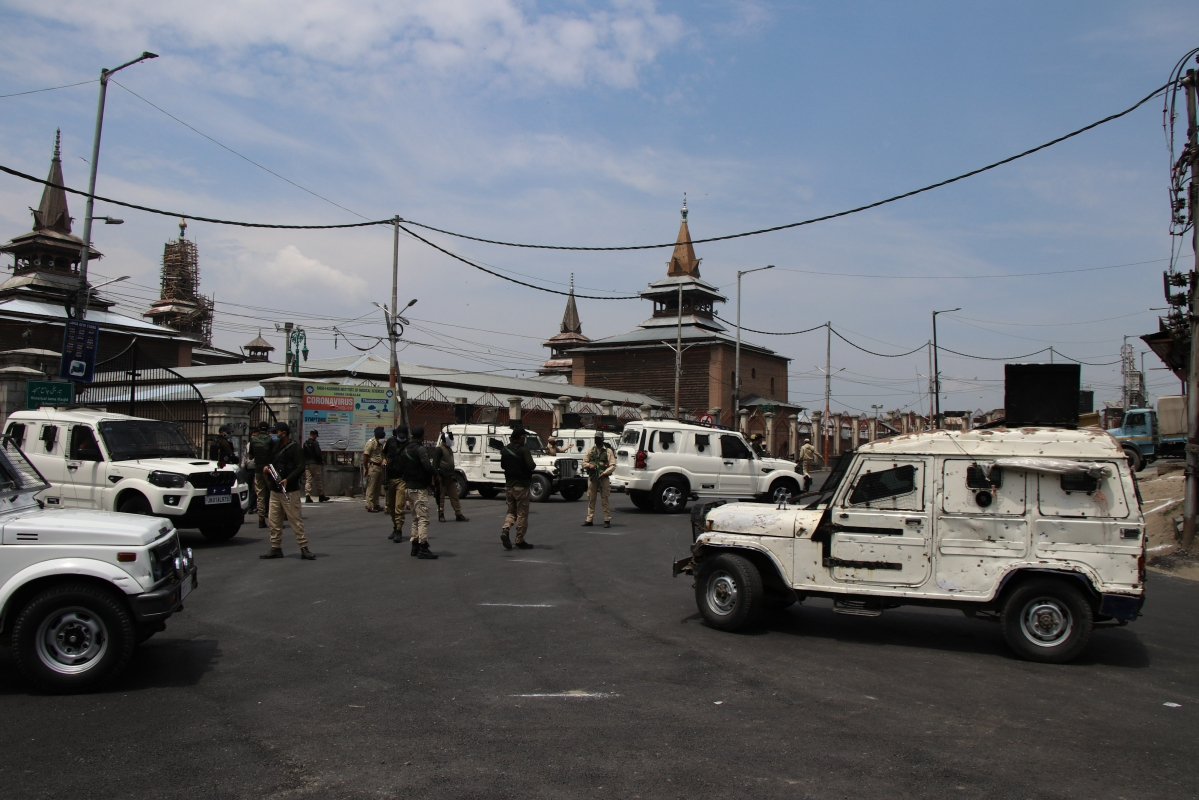 Security men stand guard on a deserted street during corona curfew in Srinagar, Kashmir. As the COVID-19 cases continue to rise the authorities imposed strict Corona curfew across Jammu and Kashmir in order to stop further spread of Coronavirus.
