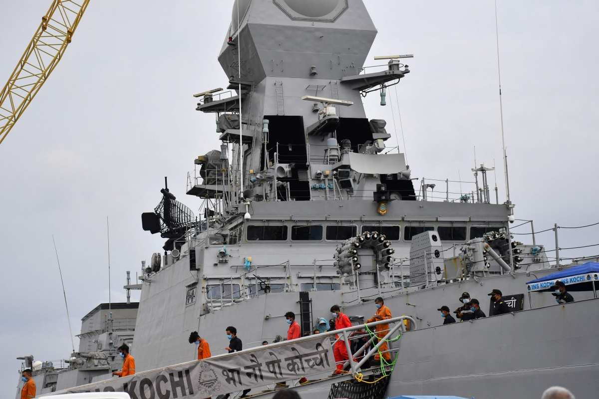 File/ Rescued crew members from the sunken offshore barge P305 look out disembark the INS Kochi naval ship after arriving in Mumbai on May 19, 2021 following Cyclone Tauktae landfall on Indias west coast with powerful winds and driving rain, leaving at least 33 people dead and almost 89 missing.