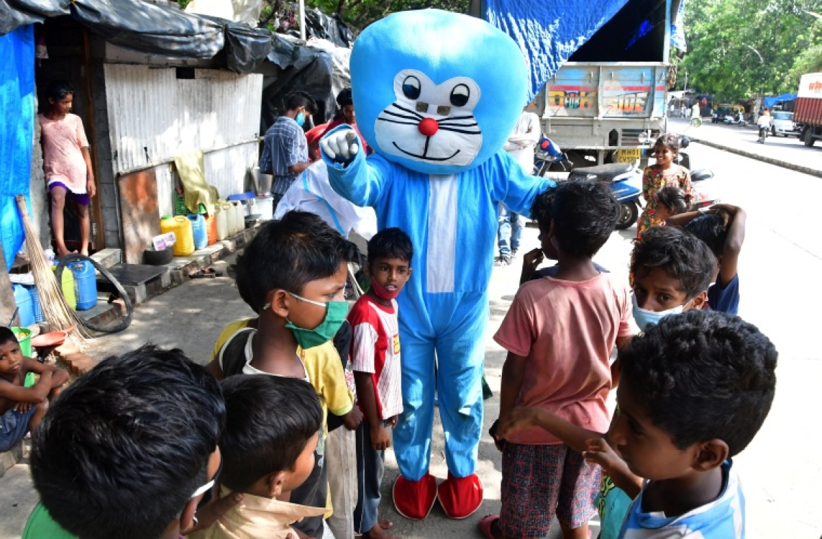 In Pics: Doraemon helps barber uncle to give haircut to slum kids in Mumbai