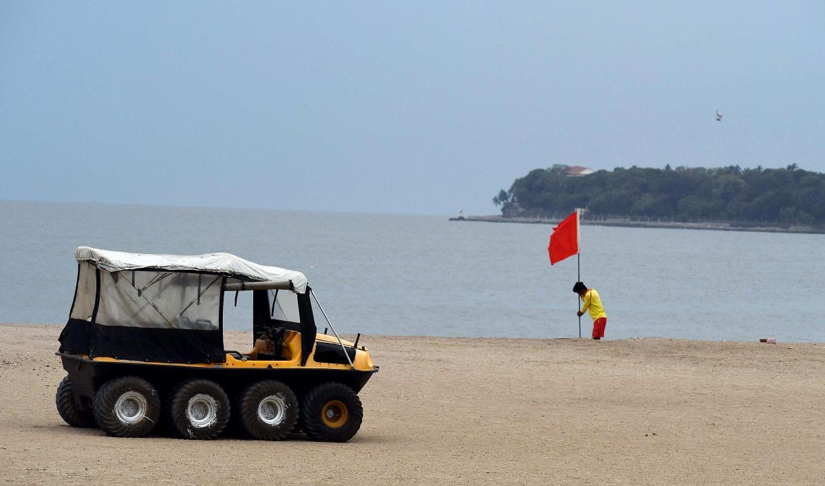 Maharashtra, May 16 (ANI): Lifeguard set Red flag at Girgaum Chowpatty to warn about cyclone Tauktae in Mumbai on Sunday.