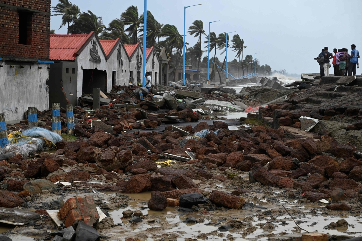 People walk through a damaged shoreline after Cyclone Yaas hit Indias eastern coast in the Bay of Bengal, at a beach in Shankarpur, some 180 km from Kolkata on May 27, 2021.