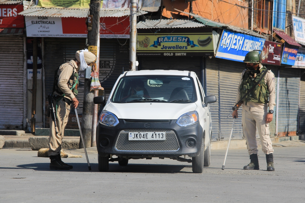 Securitymen stop a car on a street during Corona curfew in Srinagar, Kashmir. As the COVID-19 cases continue to rise the authorities imposed strict Corona curfew across Jammu and Kashmir in order to stop further spread of Coronavirus.