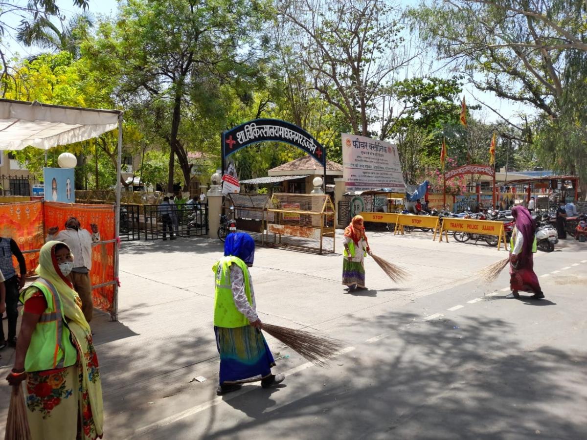 Ujjain Municipal Corporation employees sanitise the Government Madhav Nagar Hospital in Ujjain on Friday