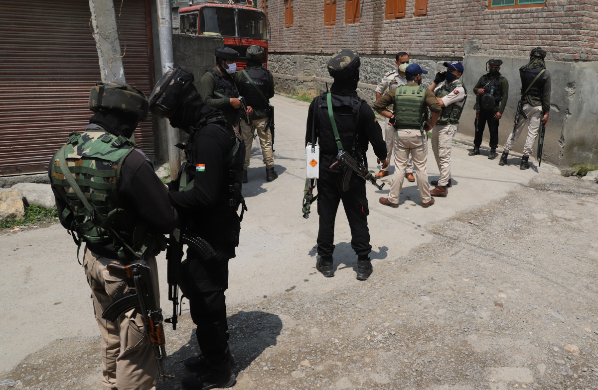 Security forces personnel near the site of encounter with militants on the outskirts of Srinagar,   Kashmir on May 17, 2021.