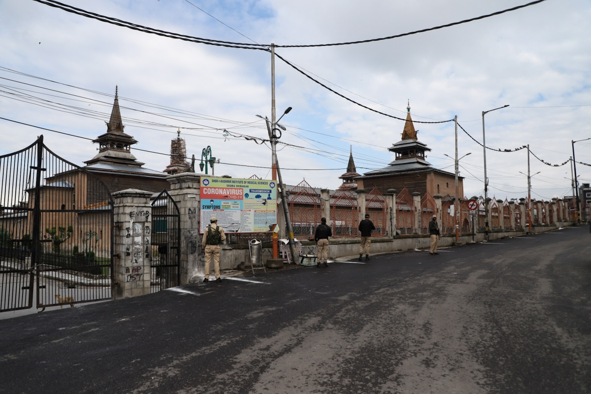 Security personnel stand guard outside the Jama mosque in Srinagar on the day of the Muslim festival of Eid ul-Fitr as strict curfew has been imposed amid concerns over the spread of Coronavirus.