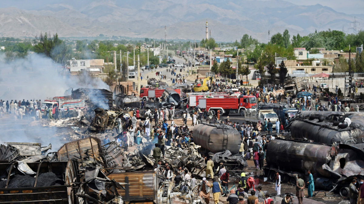 Local residents and owners of fuel tankers inspect the site following an overnight ablaze in which several fuel tankers caught fire at Qala-e-Murad Bek area on the outskirts of Kabul on May 2, 2021.