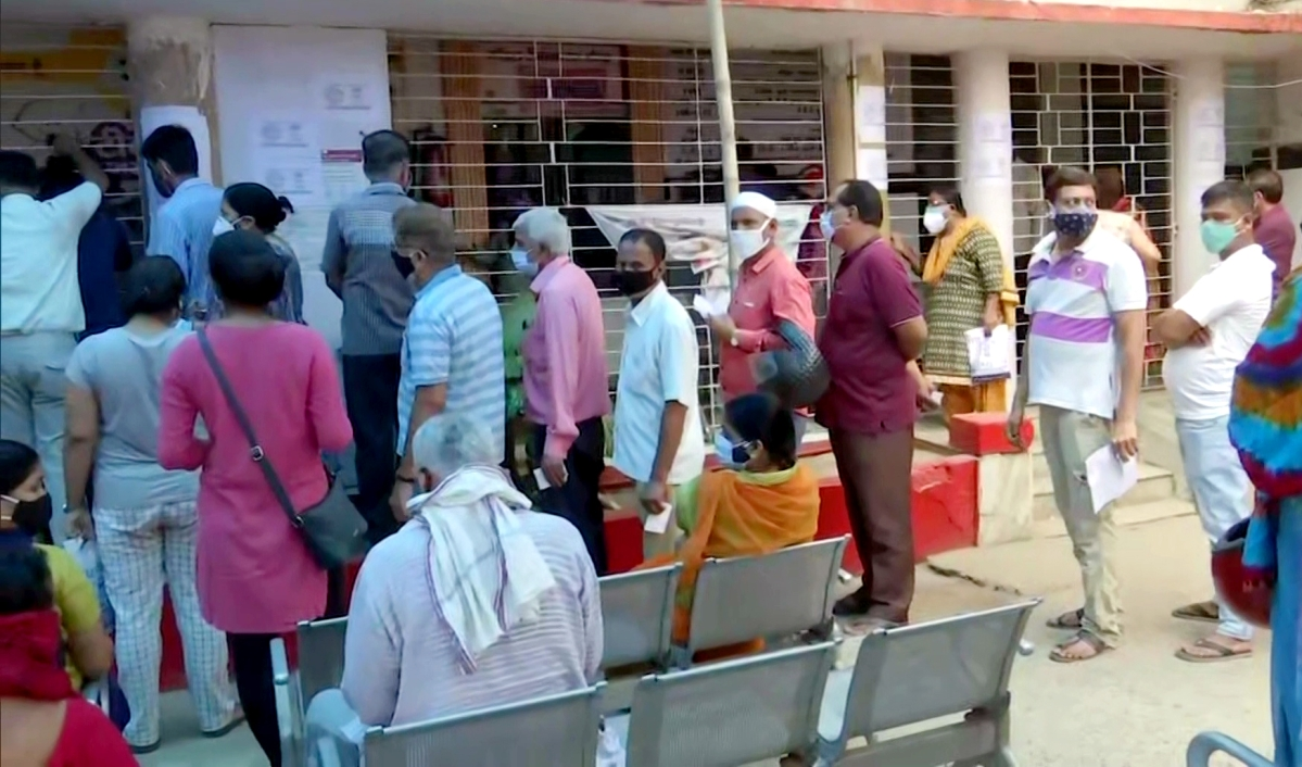 People stand in queues as COVID19 vaccination for 18 years and above commences in the state at New Gardiner Road Hospital in Patna, Bihar, on Sunday.