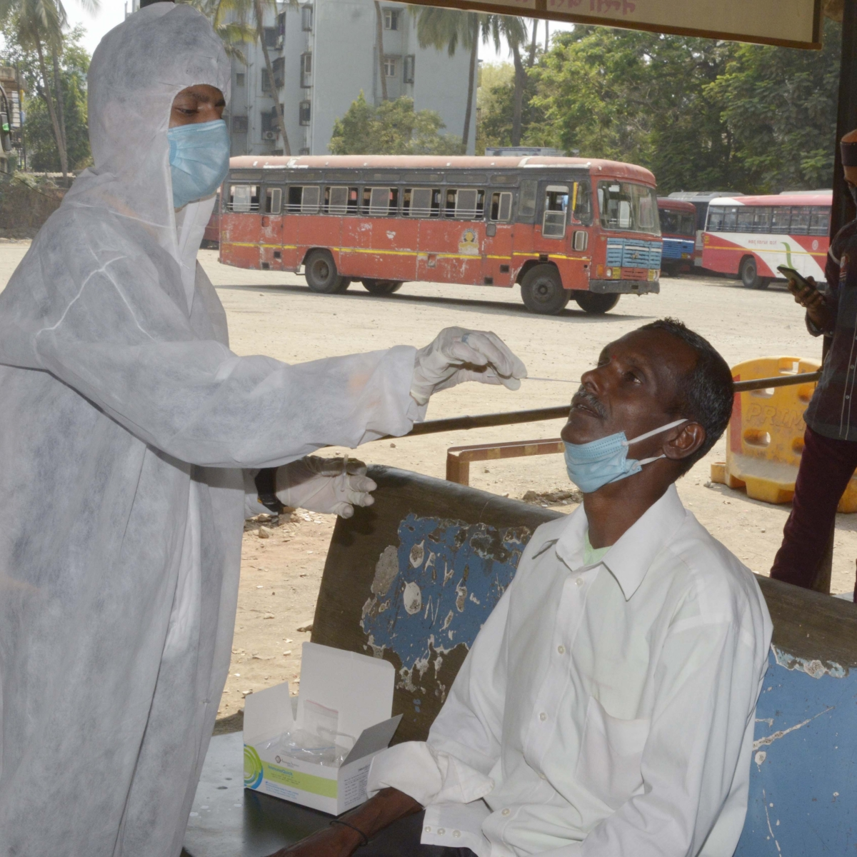 Passengers at Nensi ST bus Depo Borivali, Mumbai take swab test before travel