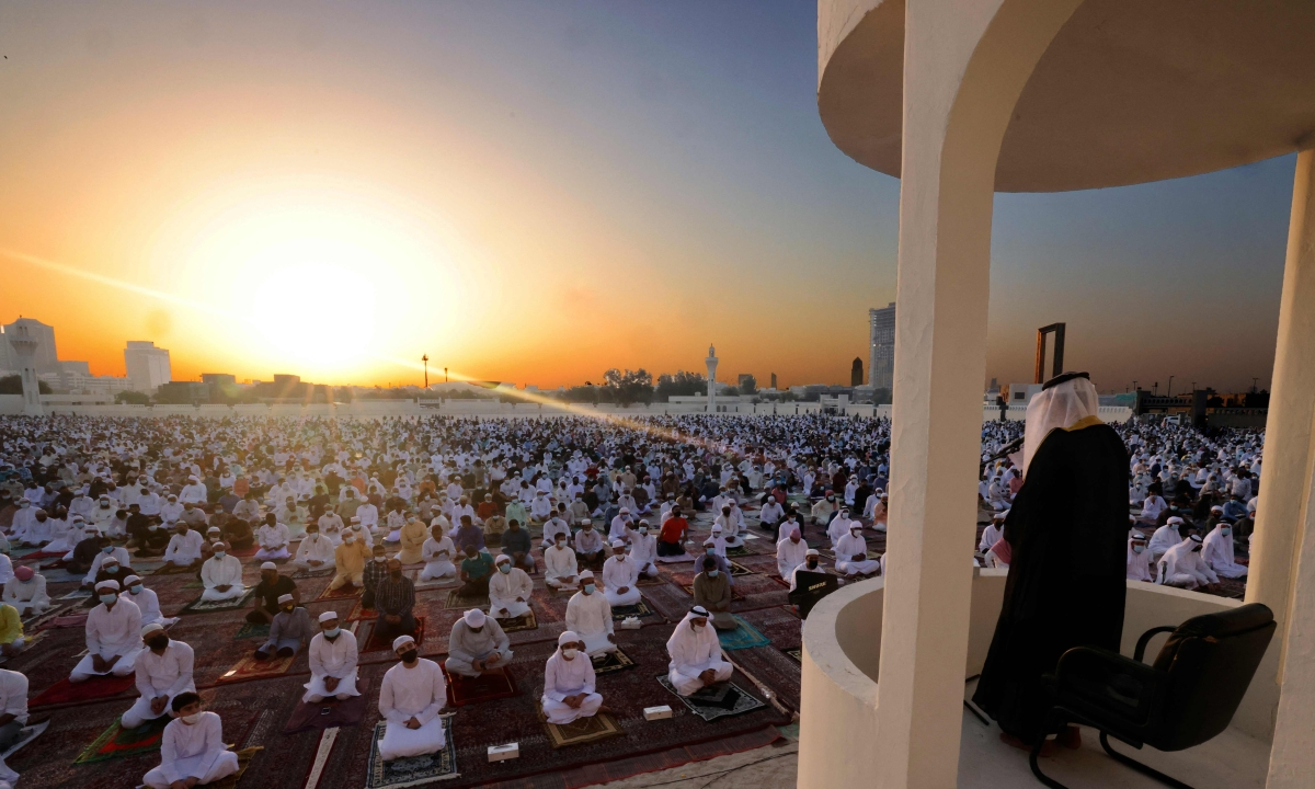 Muslim worshippers listen to the Eid al-Fitr morning prayer sermon at Dubai's Eid Musalla in the Gulf emirates old port area on May 13, 2021, as Muslims across the globe mark the end of the holy fasting month of Ramadan.