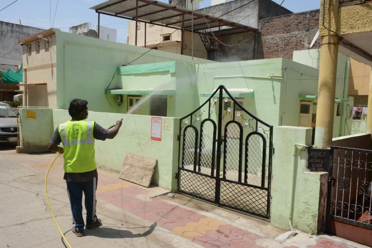 Ujjain Municipal Corporation staff sanitises houses in Ujjain on Wednesday