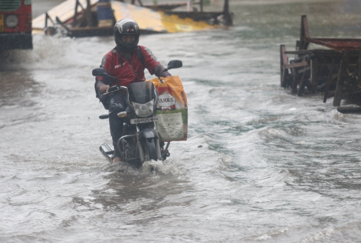 A commuter in a waterlogged area