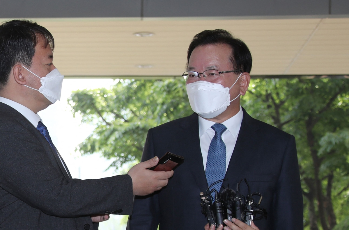 South Koreas new Prime Minister Kim Boo-kyum speaks to reporters as he arrives at the government complex in Seoul