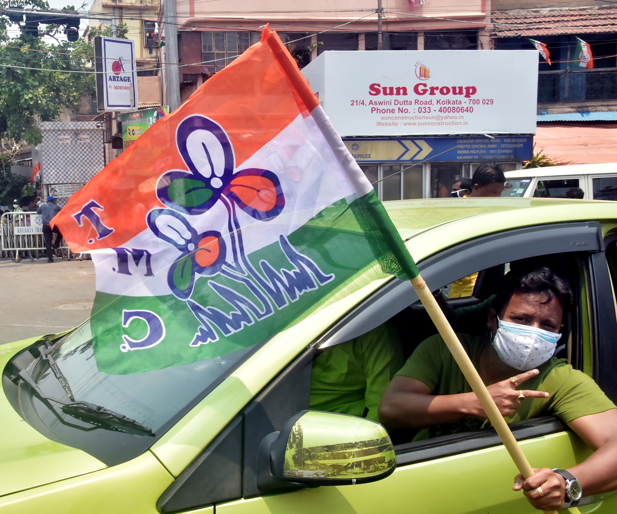TMC supporter flashes a victory sign while celebrating the party's victory in West Bengal assembly election in front of West Bengal CM Mamata Banerjee's residence, in Kolkata on Sunday.