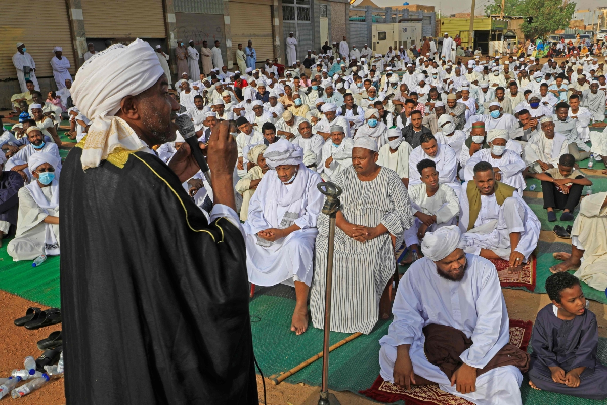 Sudanese worshippers gather to perform the Eid al-Fitr prayers in Al-Jarif, outside the capital Khartoum, on May 13, 2021.
