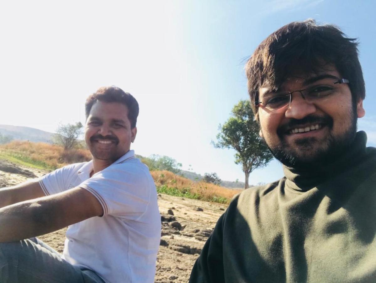 Sanket Mehta (in green) and Ganesh Nikam (in white t-shirt)