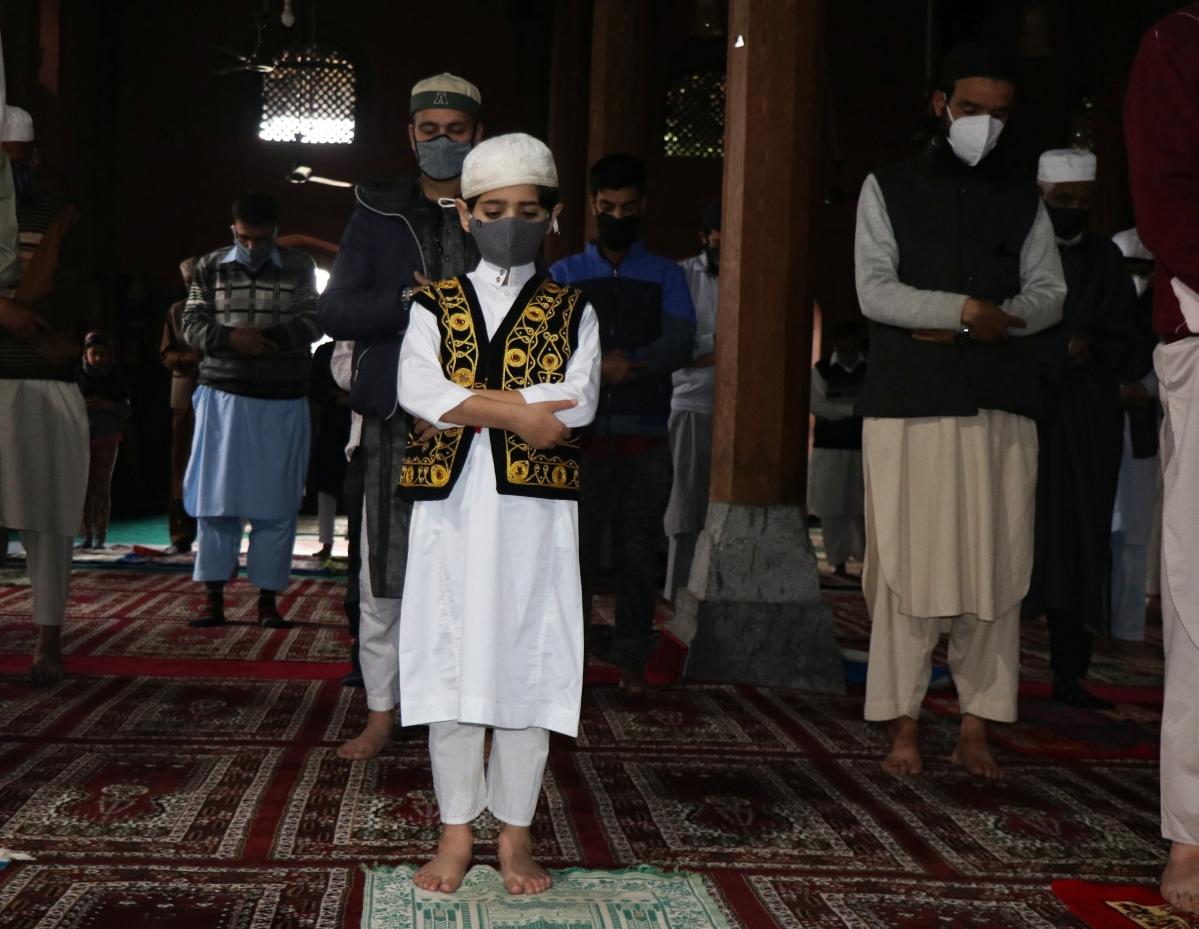 A Kashmiri child offers his prayers inside a local mosque on the occasion of Eid ul-Fitr in Srinagar, Kashmir.