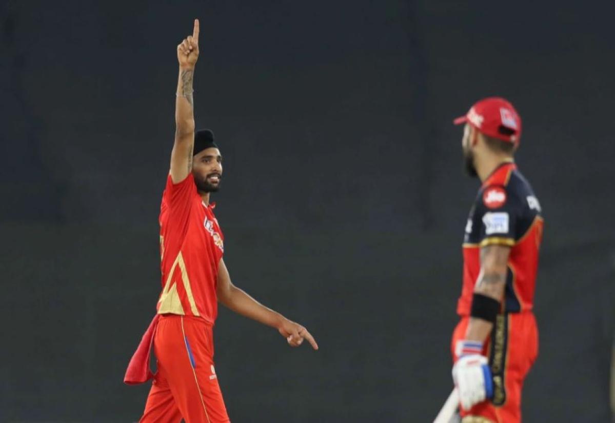 Harpreet Brar of Punjab Kings celebrates the wicket of Virat Kohli captain of Royal Challengers Bangalore