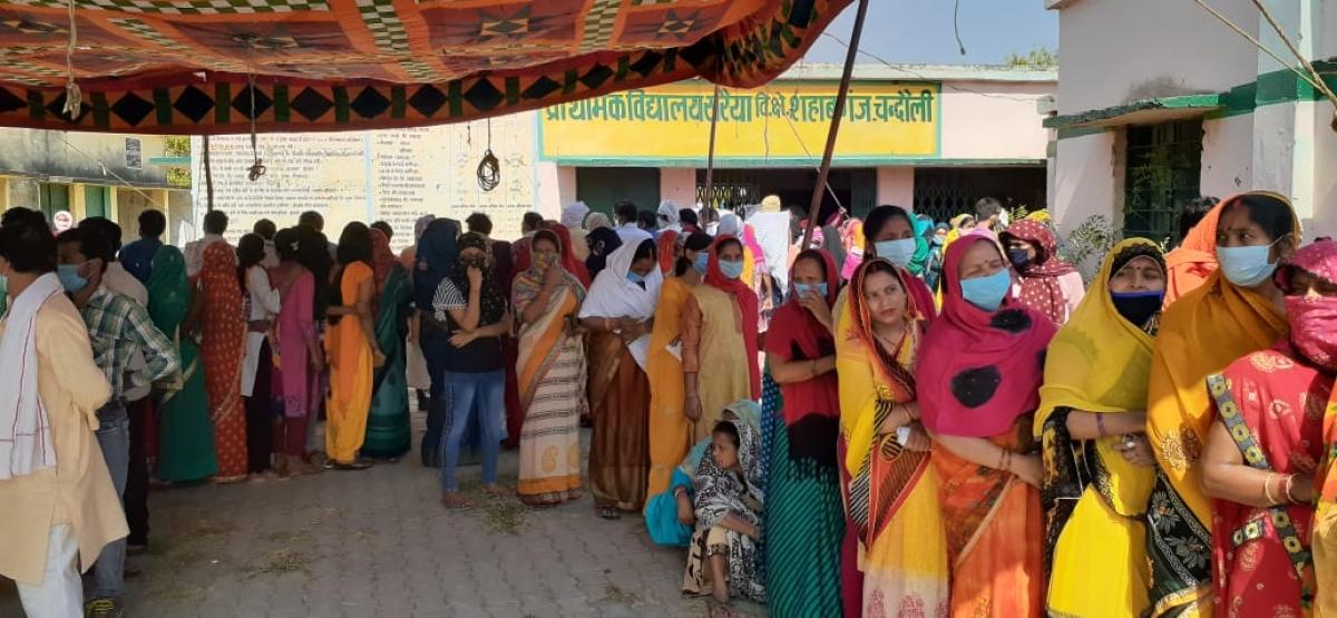 Female voters queue up at Sahib Ganj,  Chandauli.