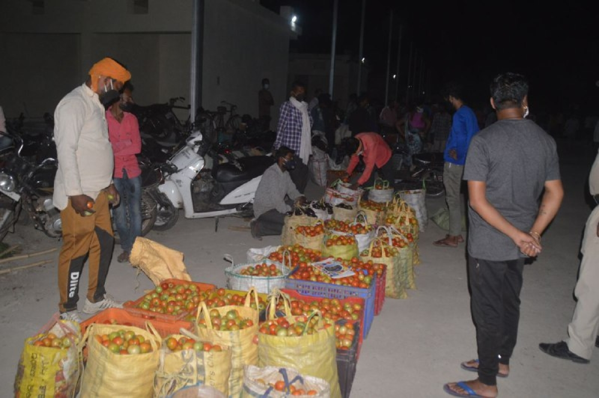 Farmers selling vegetable at vegetable market in Rewa town late on Sunday night