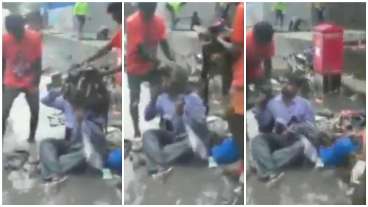 Watch: Sena Chandivali MLA Dilip Lande makes contractor sit on waterlogged road, asks workers to dump garbage on him