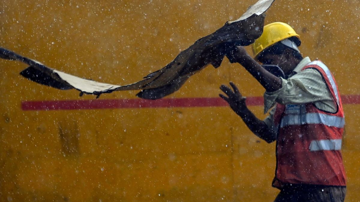 In Photos: As rain lashes Delhi, citizens get much-needed respite from heat