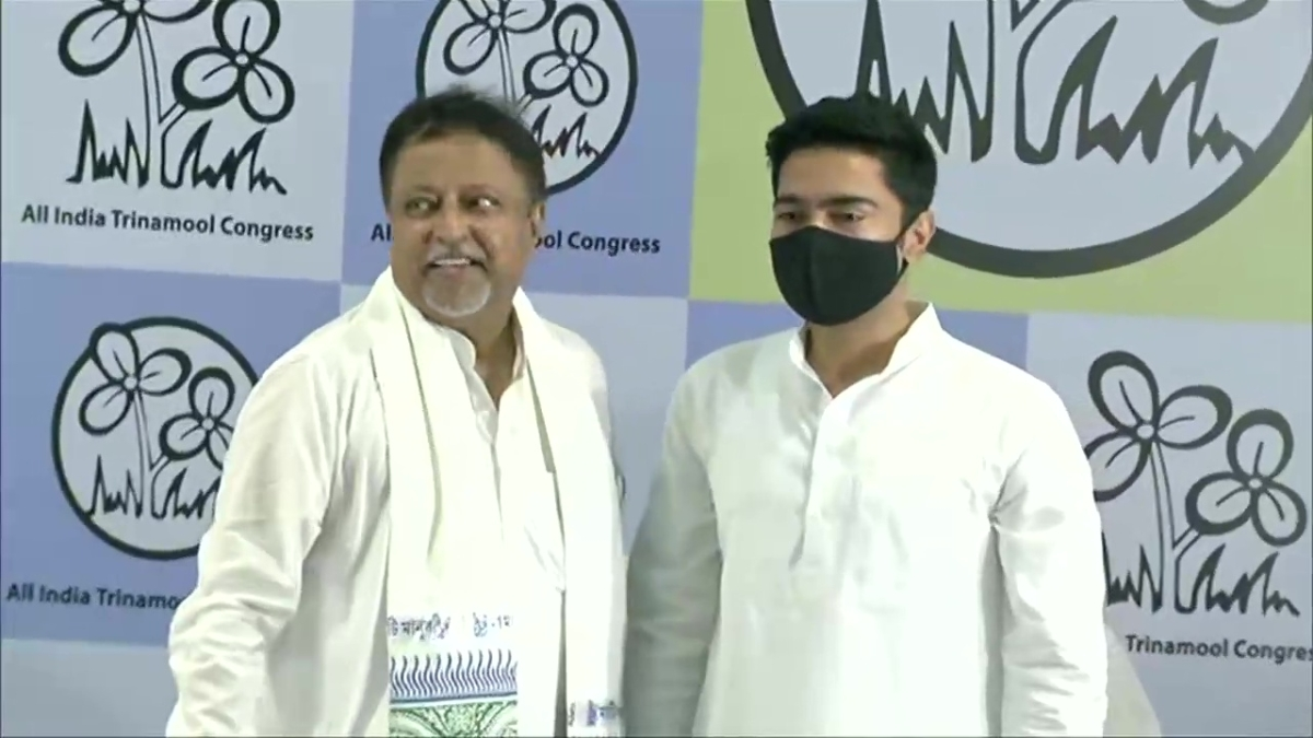 BJP national vice president Mukul Roy, son Subhranshu join TMC in presence of Mamata Banerjee