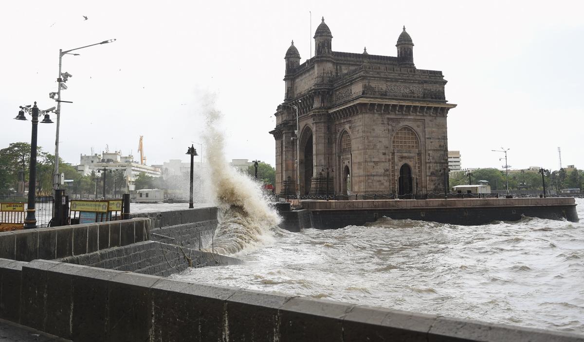 Mumbai: Sea waves crash ashore near the Gateway of India during high tide in Mumbai, Friday, June 11, 2021.