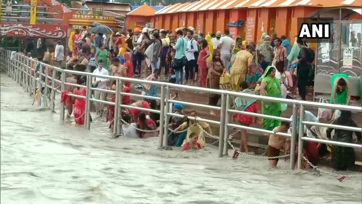 In Photos: Devotees line up to pray, take a holy dip at Varanasi and Haridwar on Ganga Dussehra amid Covid-19 lockdown