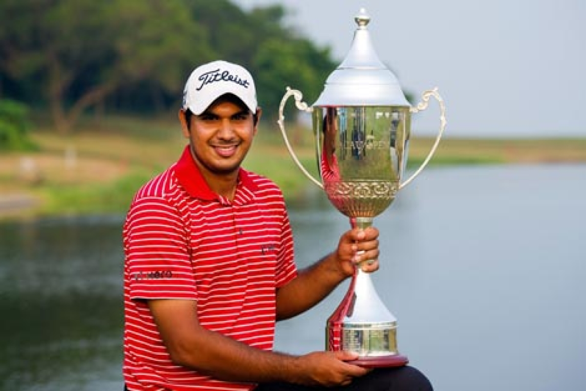 Gaganjeet Bhullar holding the winner's trophy after his victory in the Venetian Macau Open 2012 golf tournament at the Macau Golf and Country Club on Sunday. Bhullar posted a 16-under par to secure the 118,875 USD winner's cheque.