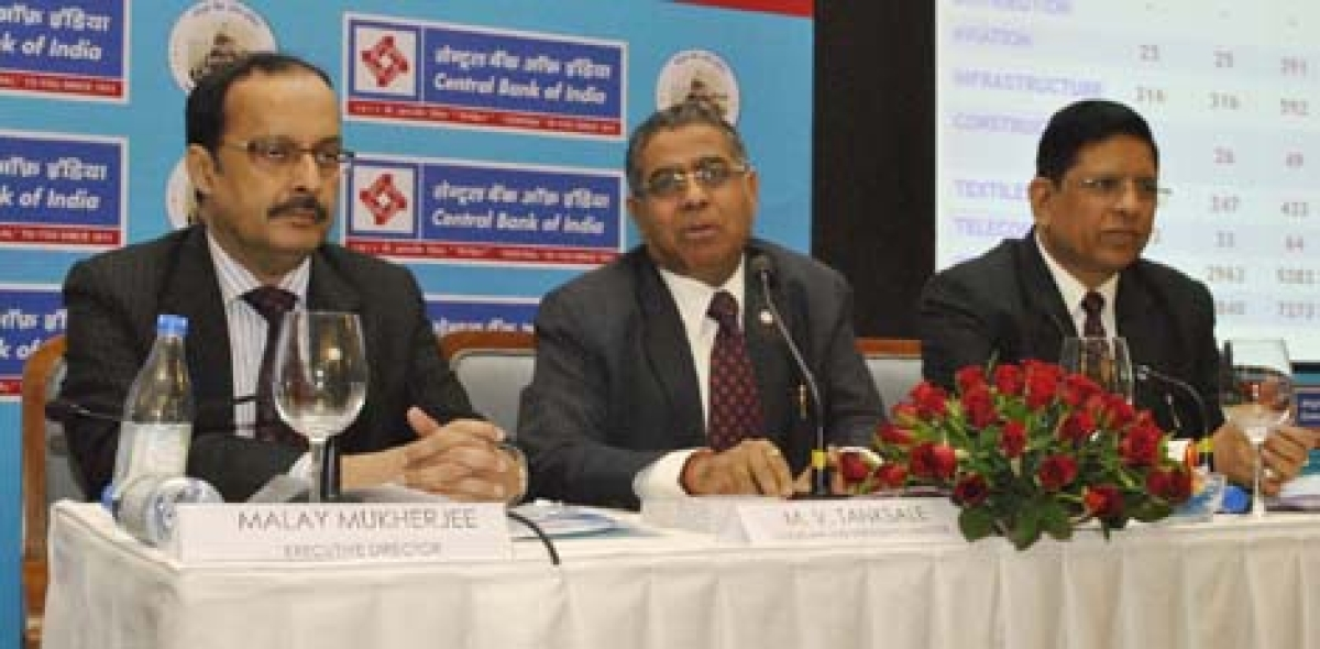 Executive Director of Central Bank of India (CBI) Malay Mukherjee, Chairman & MD M.V Tanksale and Executive Director R.K Dubey interact with the media during the   announcement of the bank's second quarter results in Mumbai on Tuesday.