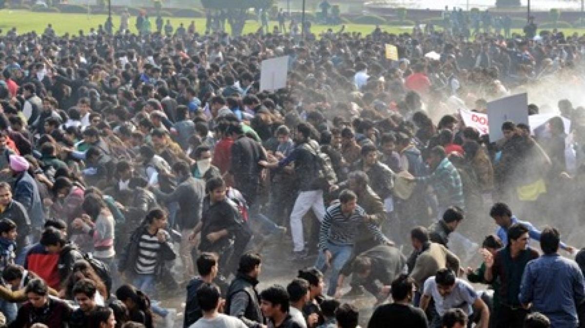 Dozens injured as gang-rape protests turn violent