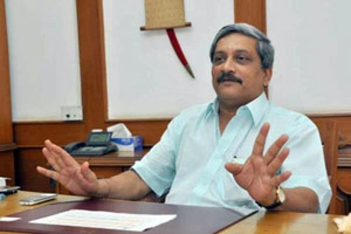 Congress takes on Parrikar, backs Catholic priest