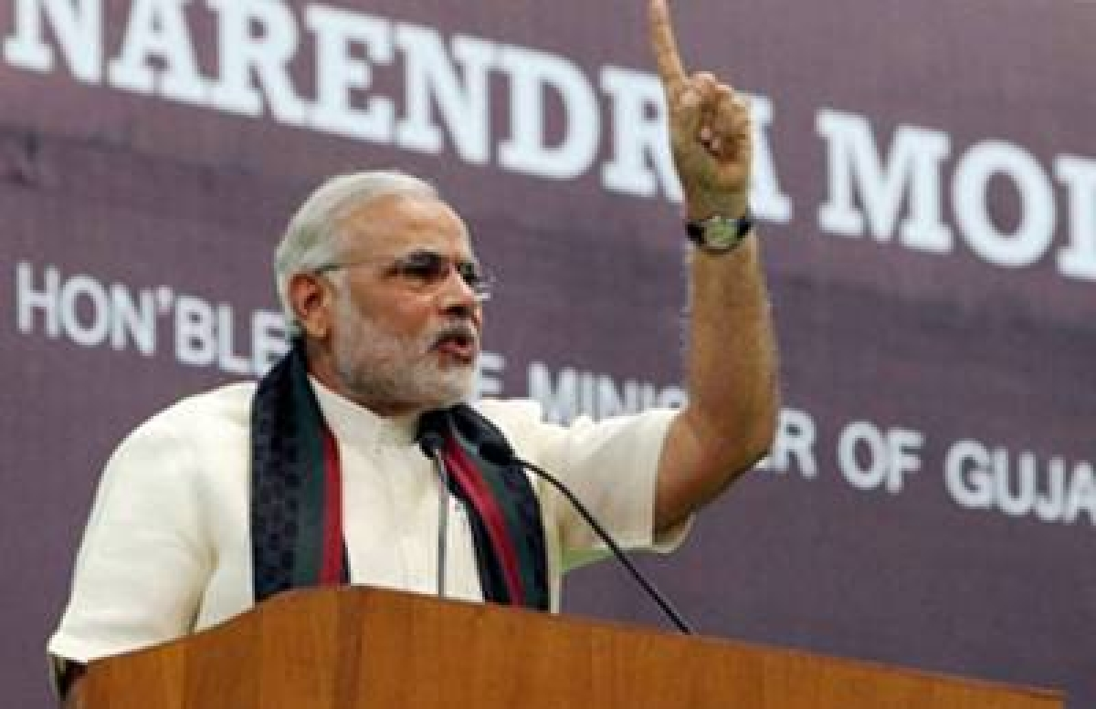 Modi Modi owns up PM ambition, wants to repay India's debt