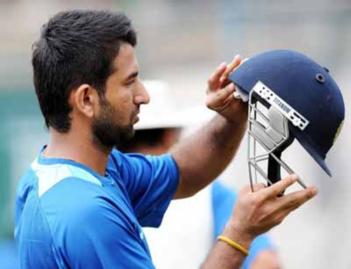Comparison with 'wall' Dravid, a  morale-booster for me: Pujara
