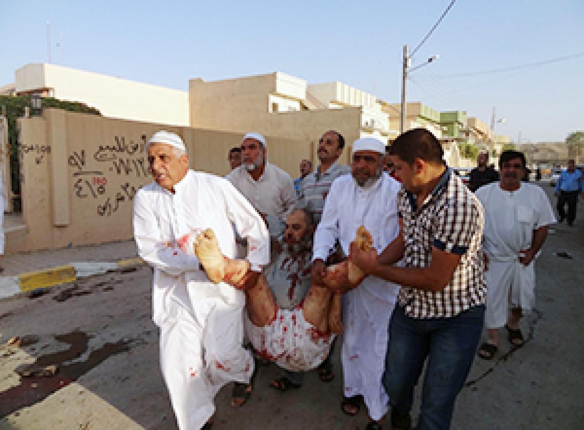 Bombing near Sunni mosque  in Iraq kills 12 worshippers