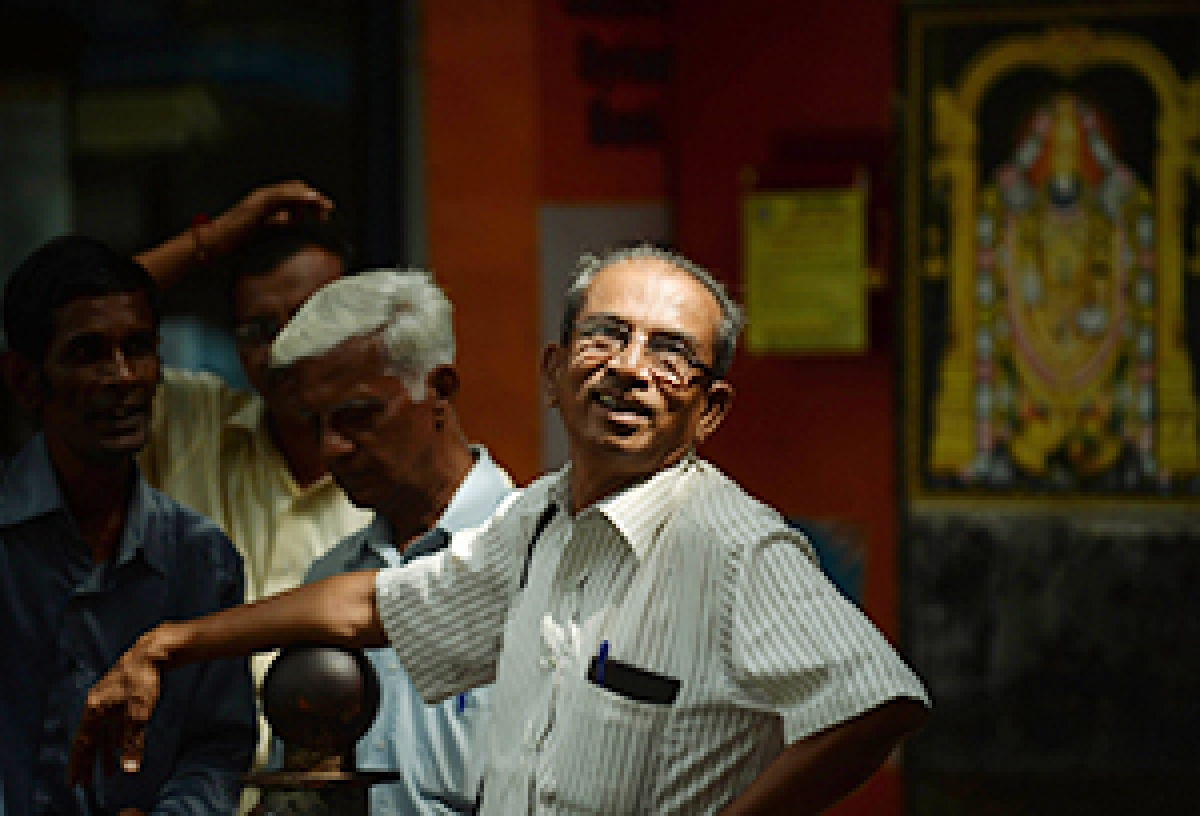 An bystanders watch share prices on the digital<br />broadcast on the facade of Bombay Stock Exchange on Thursday. Sensex jumped to its highest level in nearly three years on, crossing the 21,000 points threshold.