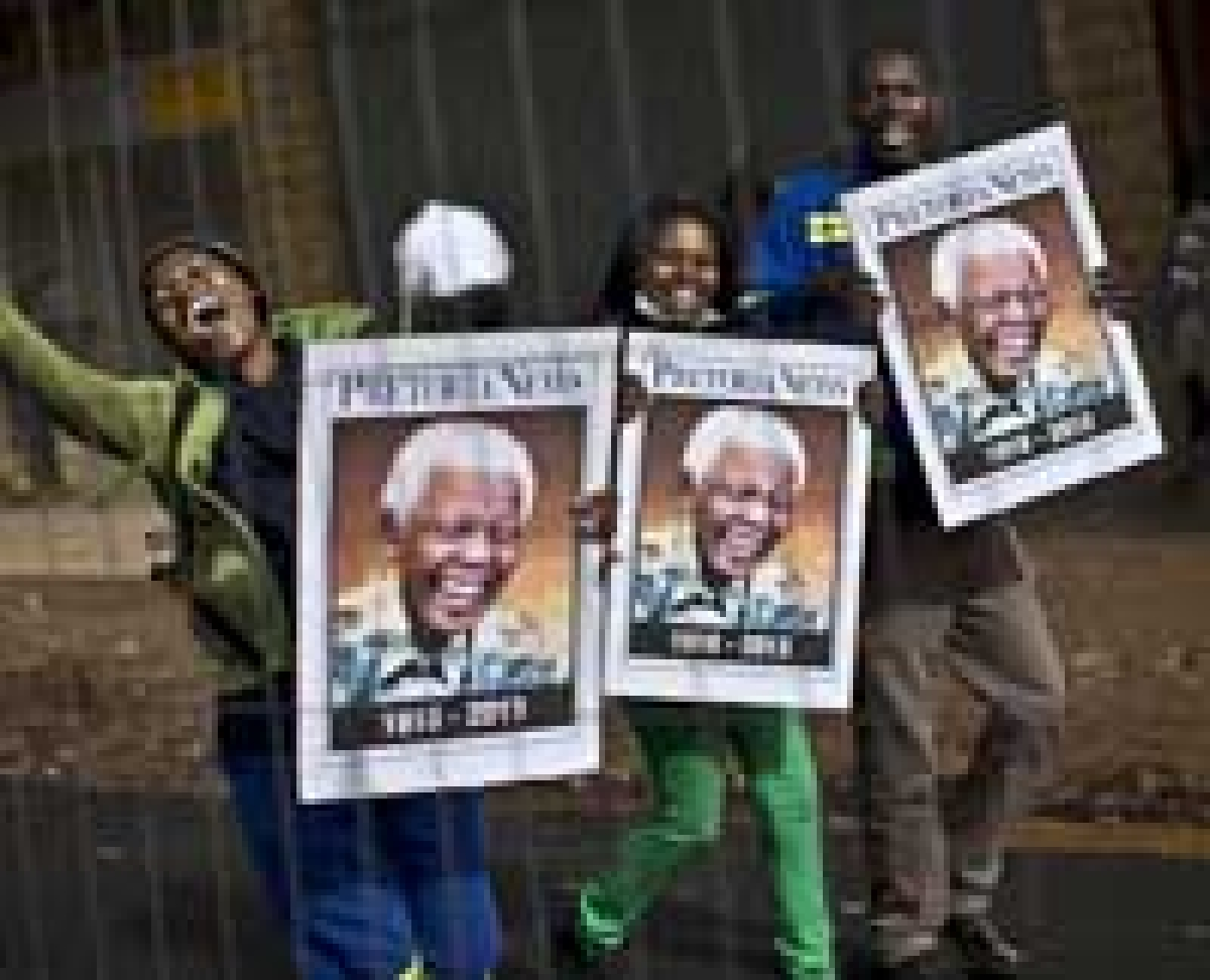 Left: Mourners celebrated Mandela's<br />life as they watched the progress of the convoy.<br />Below: Naomi Campbell, whom Mandela described as a 'granddaughter' to him, wept as she visited the casket.