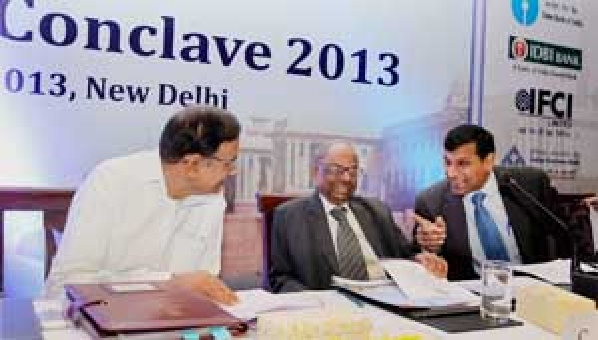 Finance Minister P Chidambaram with former RBI<br />Governor and Chairman of the PM's Economic Advisory Council C Rangarajan and RBI Governor Raghuram<br />Rajan, during the inauguration of the Delhi Economics Conclave 2013 in New Delhi on Wednesday.