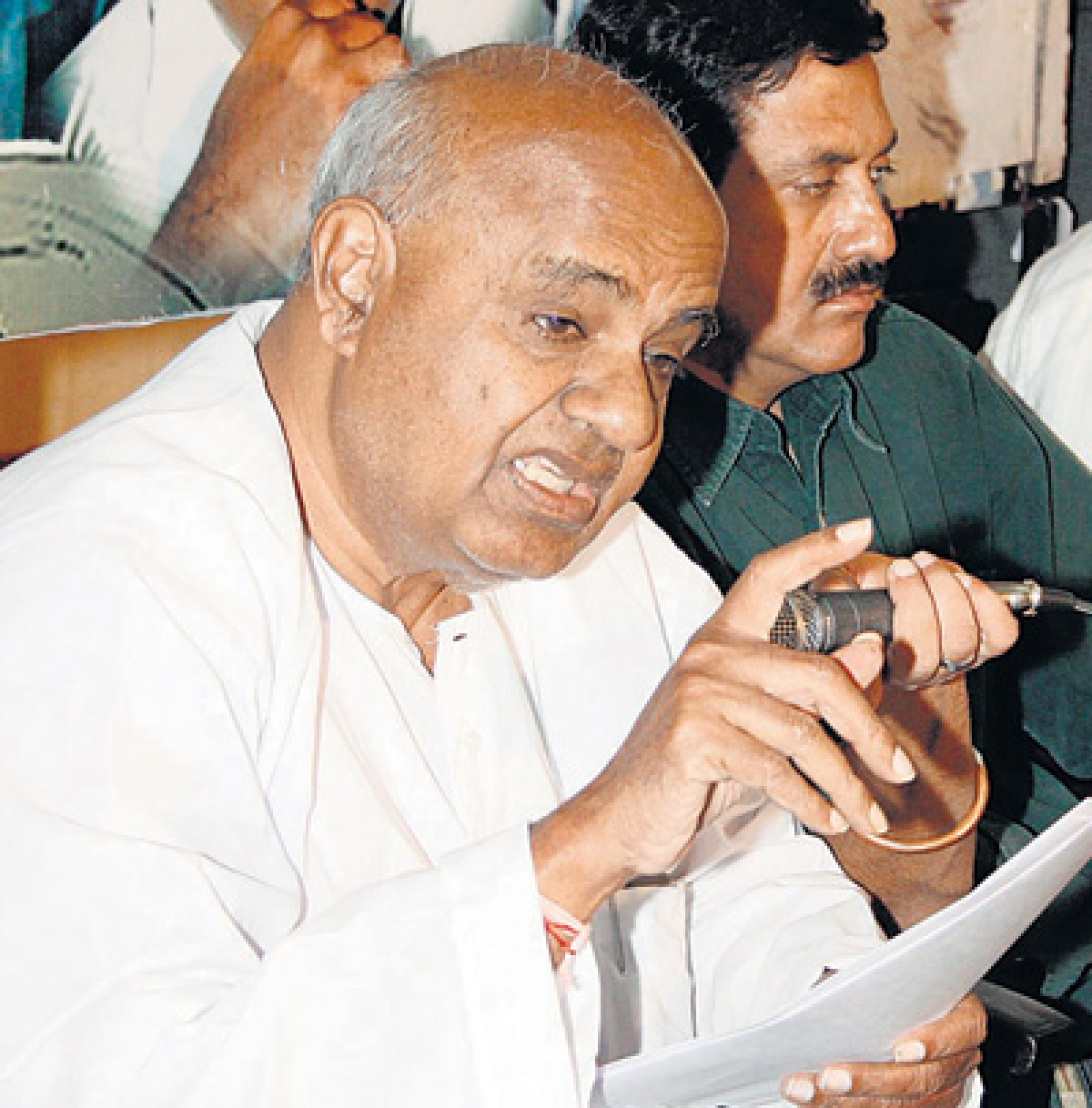 Gowda flays rail fare hike, questions govt's hurry