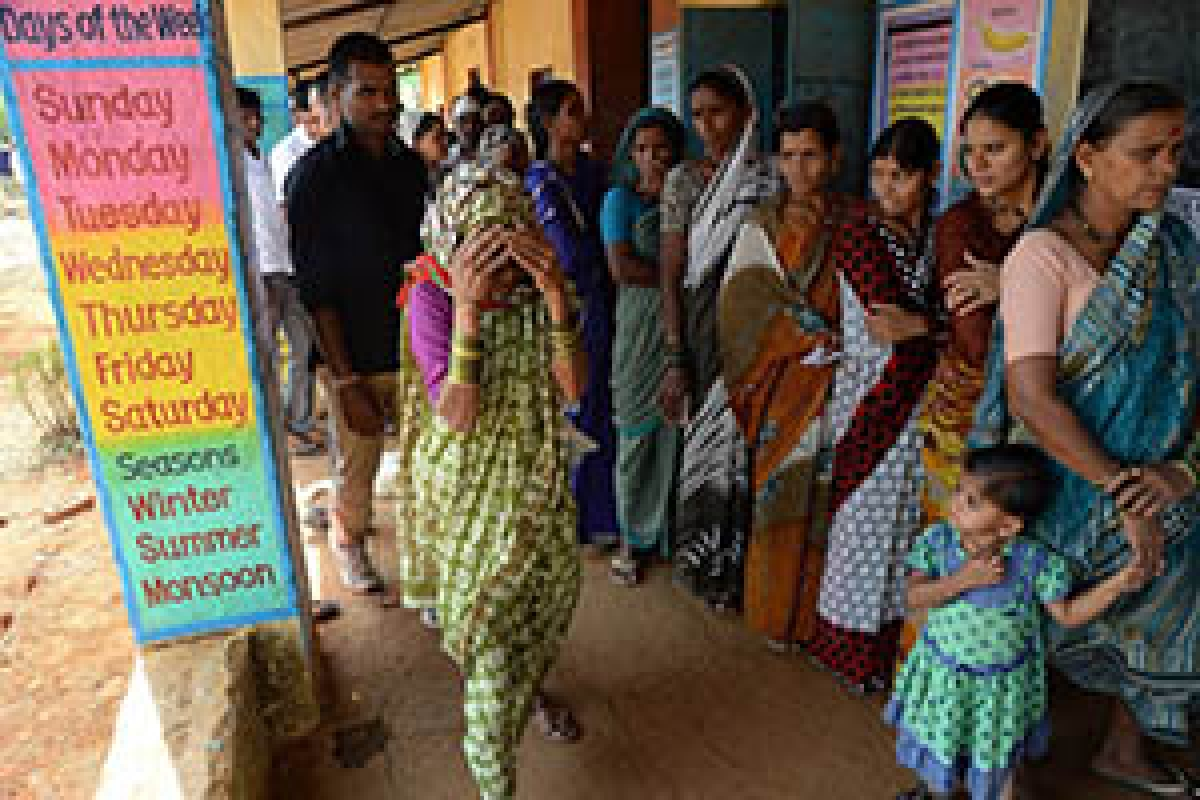 An elderly voter, who was discharged from hospital after cataract surgery, arrives to cast her vote at a polling booth inside a primary school in Shirgaon village of Pune district,  some 130 kms south-east of Mumbai on Thursday