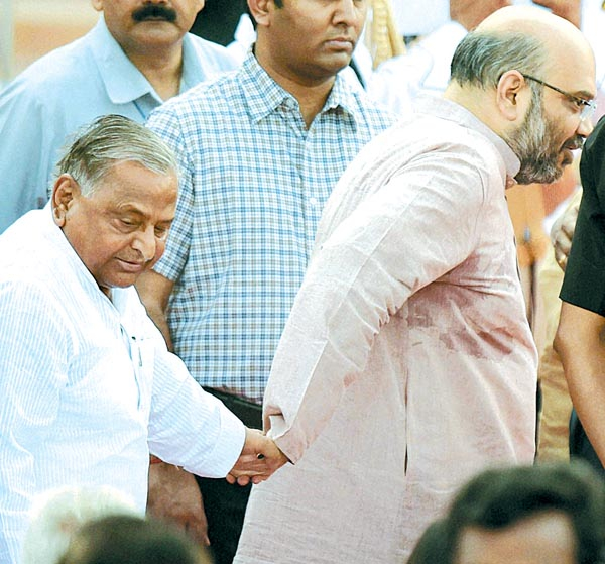 SIGN OF TIMES: BJP leader Amit Shah and SP chief Mulayam Singh Yadav giving each other a hand.