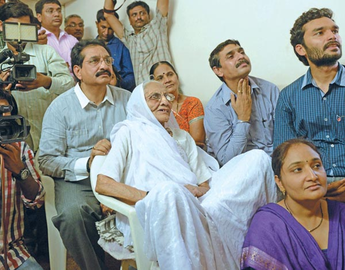 NOTHING LIKE HOME: Hiraba , Narendra Modi's mother, riveted to the TV screen at her home in Gandhinagar.