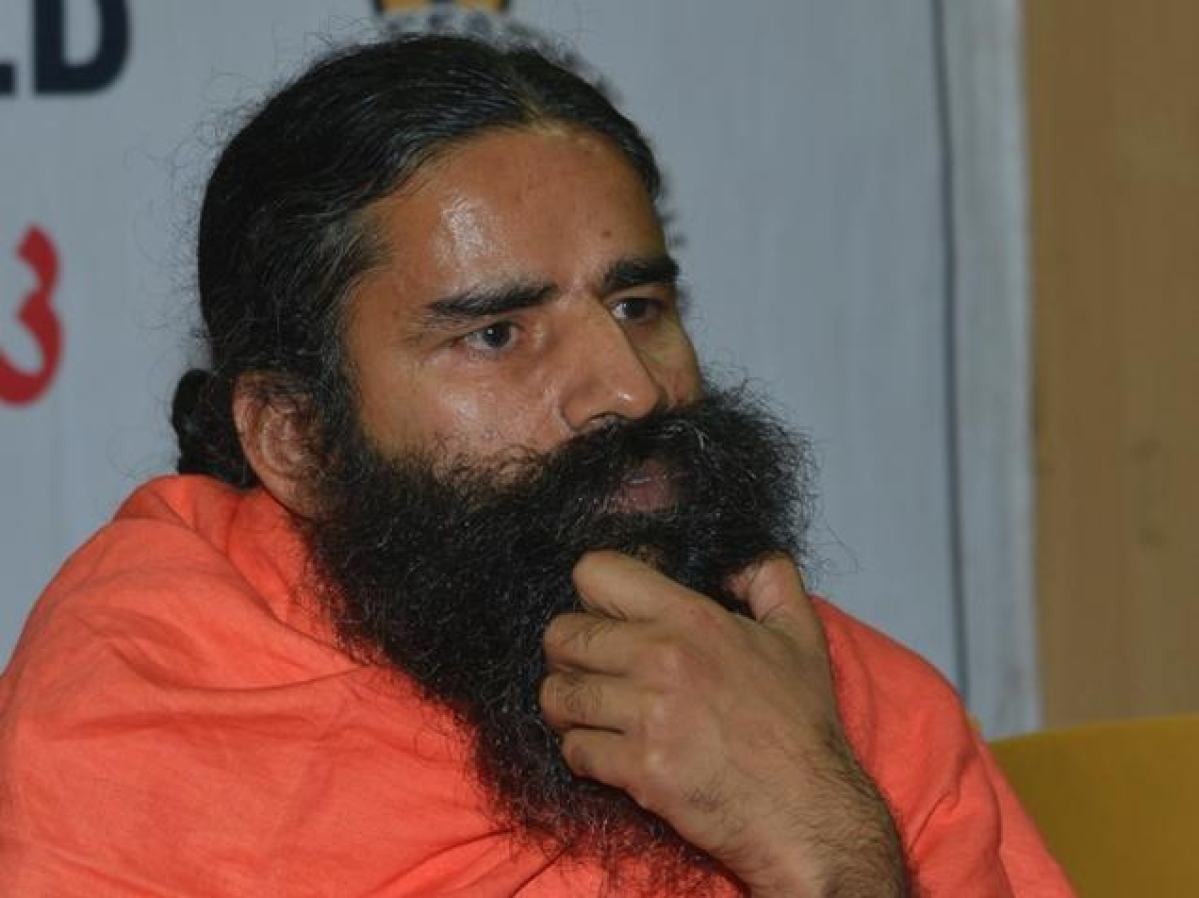 Smarting under statement withdrawal, Ramdev poses 25 questions to IMA