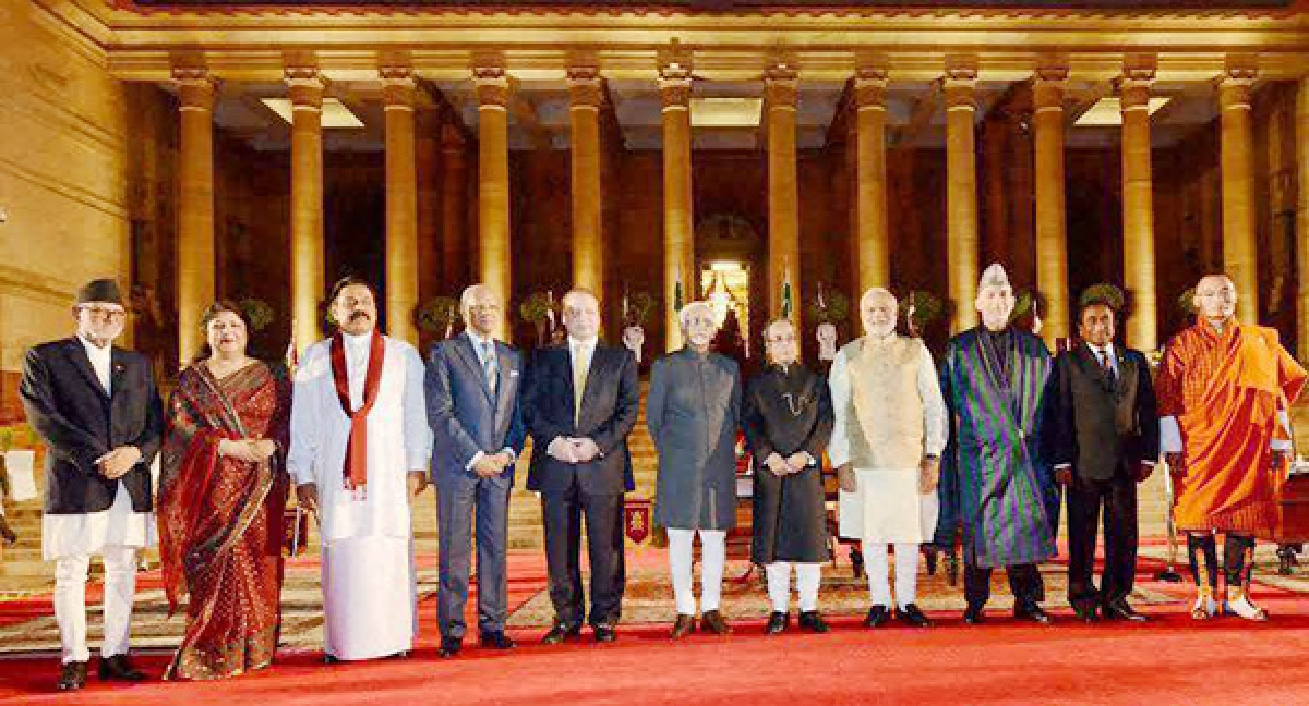 President Pranab Mukherjee, Vice President Hamid Ansari and Prime Minister Narendra Modi with heads of SAARC countries after the swearing-in ceremony at Rashtrapati Bhavan in New Delhi on Monday.